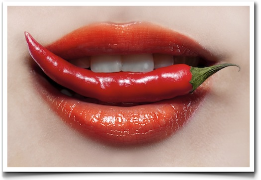 woman biting chilli