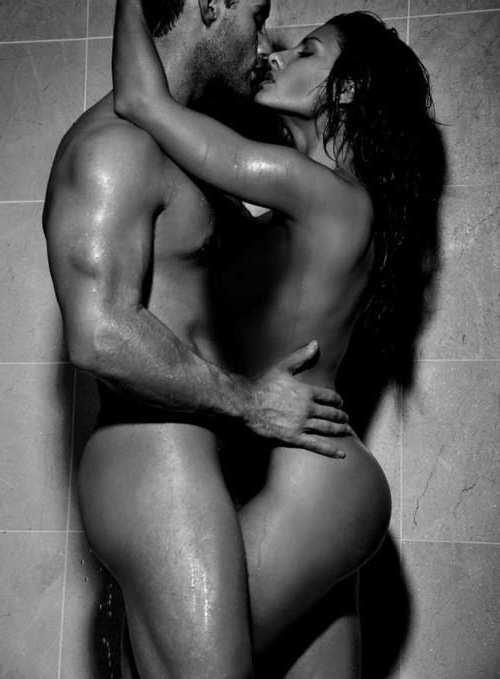 couple in black and white kissing in the shower