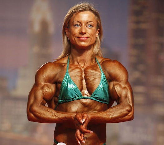 shredded female bodybuilder in green bikini