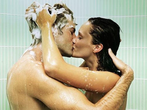 man and woman showering while kissing