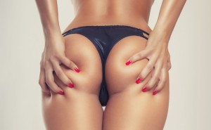 girl with red fingernails grabbing her butt