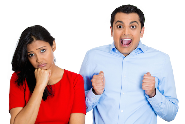 Couple, woman excited, man sad