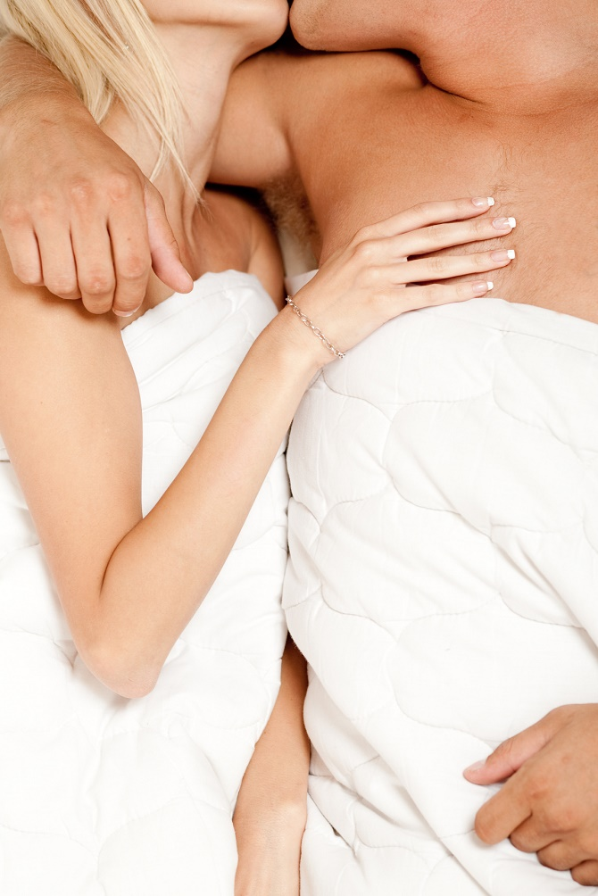 Couple in bed embracing