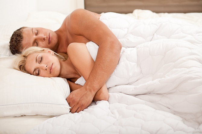 Young couple sleeping and hugging