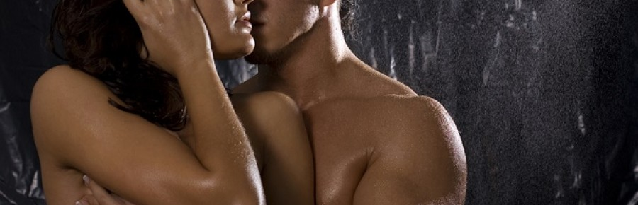 Loving nude couple in shower