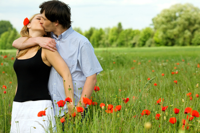 Loving couple sharing a pasionate kiss