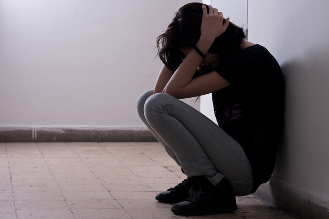 emotional-abuse-signs-woman-on-floor