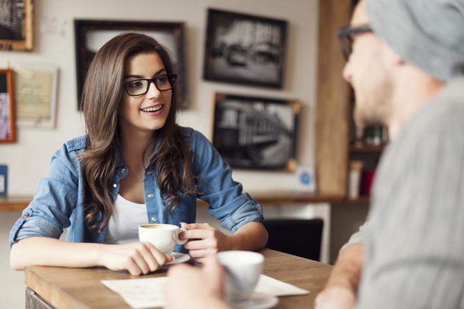 Stylish couple talking at cafe