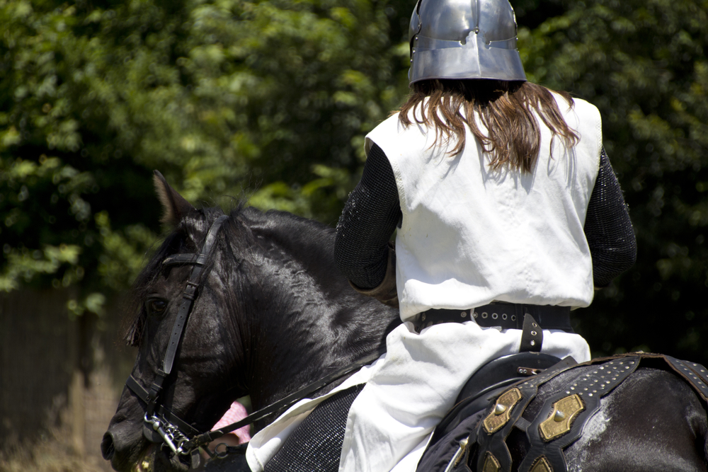 medieval knight on his horse galloping