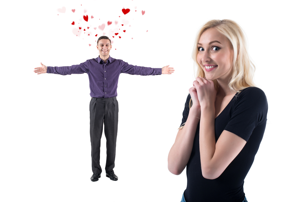 Man in love with flying valentines hearts wide open hands hugs and beautiful lovely girl adores to see him
