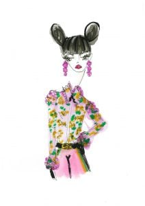 woman with her hair in two buns, floral shirt and pink trousers