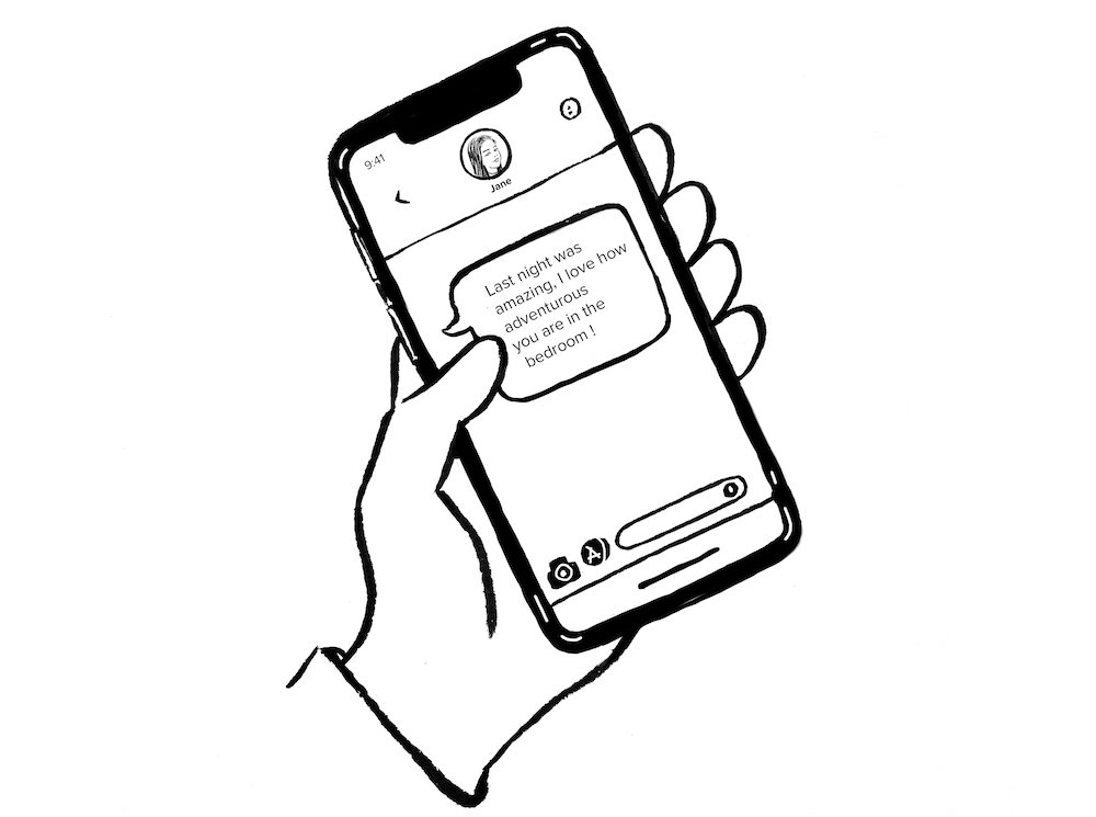 text message on phone being held in left hand